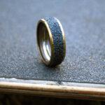 gold metal ring, skateboard, ring, steel