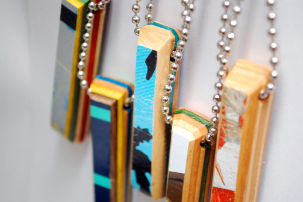 recycled skateboard, wood necklaces